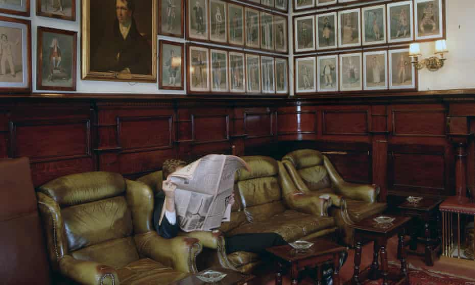 A member reading the paper in the lounge at the Garrick Club in London.