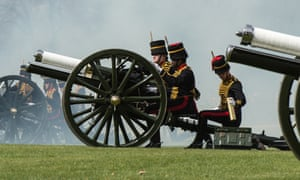 A gun is reloaded during a salute to mark the birthday, in Hyde Park, London