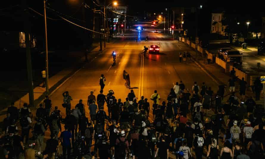 Demonstrators march in the streets on Wednesday in Kenosha, Wisconsin.