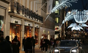 Christmas lights and shoppers on New Bond Street in central London