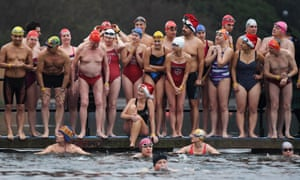 Swimmers take part in the Christmas Day swim in the Serpentine in London.