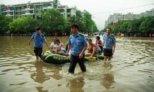 Police rescue citizens in Nanjing, Jiangsu province, China, on 5 July.