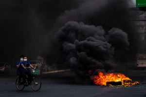 Smoke rises from tyres set alight by anti-coup protesters in Yangon.