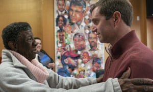 Andy Beshear speaks with Maddie Jones, of West Louisville, during a campaign stop in Louisville, Kentucky, on Tuesday.