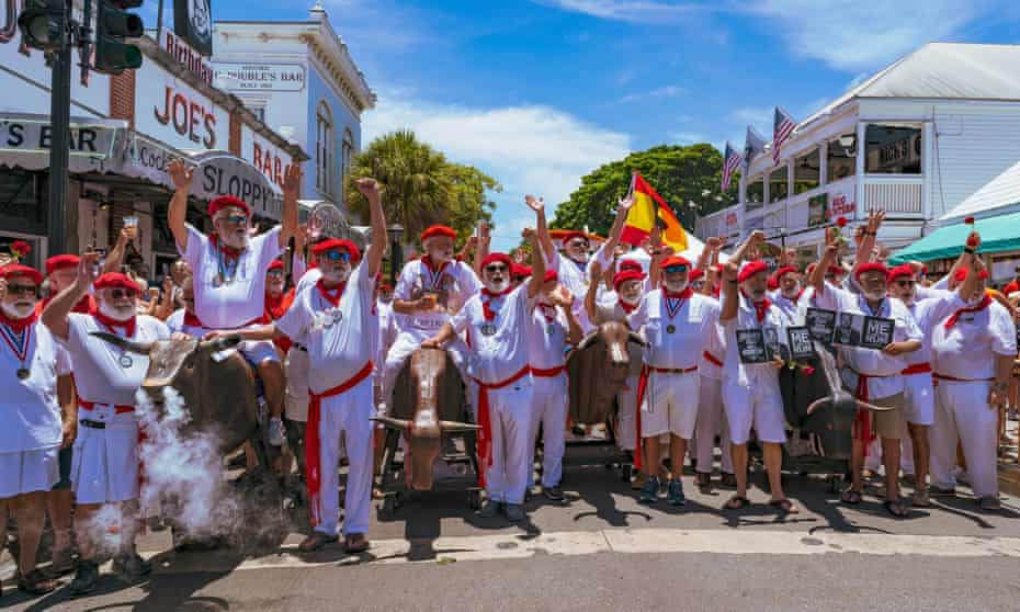 Participants in Key West's annual lookalike context take part in a spoof 'running of the bulls' event