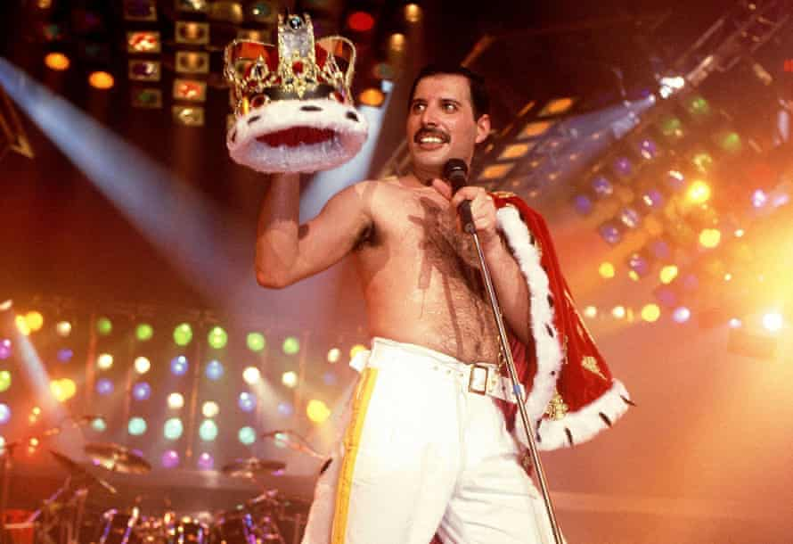 FREDDIE MERCURY OF QUEEN PERFORMING IN STOCKHOLM, SWEDEN, IN 1985, HOLDING A CROWN
