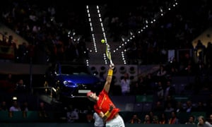Nadal serves in front of his fans.