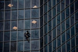 Paris, France Alain Robert, popularly known as the French Spiderman, climbs the Total tower in Paris's La Defense business district to show support for striking workers on the 40th day of a nationwide movement against pension changes