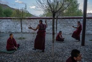 Tibetan Buddhist nuns debate in the courtyard