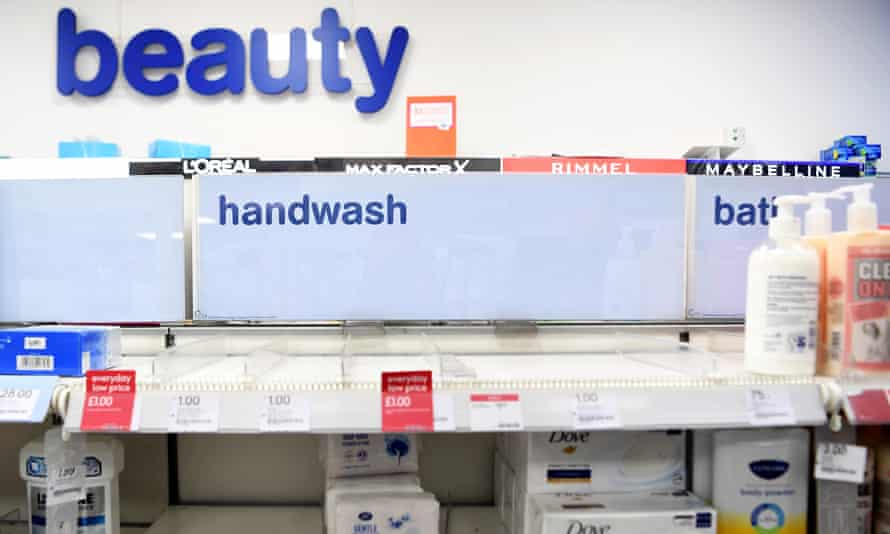 Shelves are left empty in a store after customers stock up on hand sanitisers.