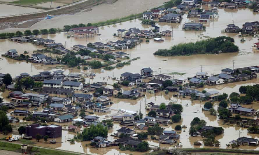 An aerial view of flooded homes in southwestern Japan, where more than 50 people have died due to extreme weather conditions.