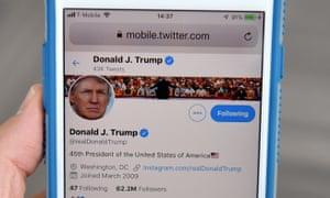Phone screen showing Donald Trump's Twitter account