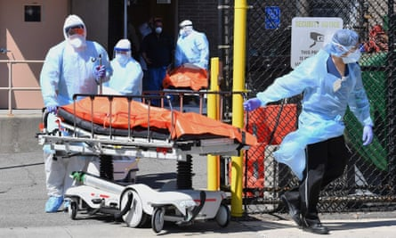 Medical staff move bodies from the Wyckoff Heights medical center to a refrigerated truck on Thursday in Brooklyn, New York.