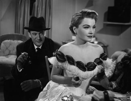 Anne Baxter as the duplicitous Eve and George Sanders as the theatre critic and narrator in All About Eve.