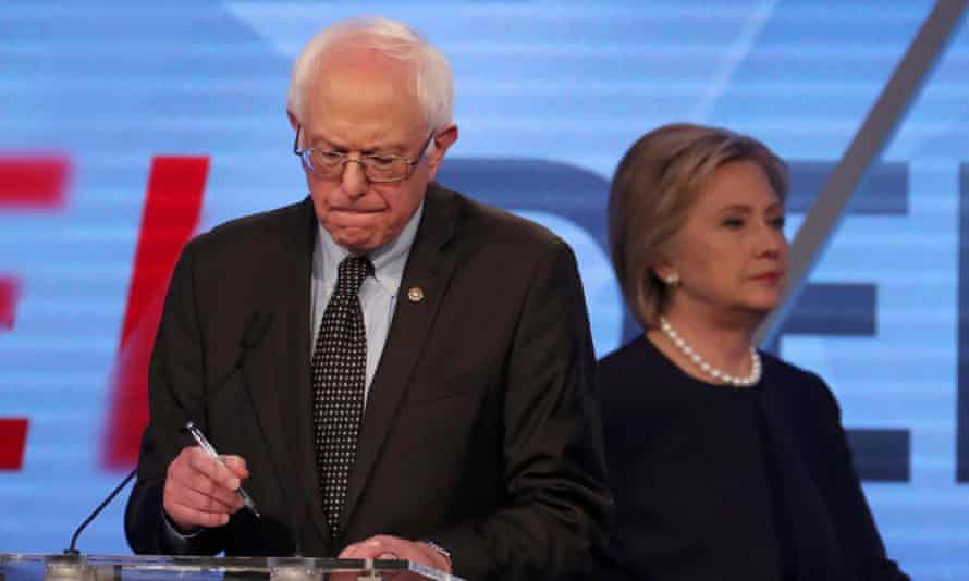 Bernie Sanders and Hillary Clinton during a break in a Democratic debate on 9 March.