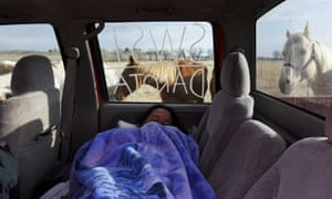 Seth Eastman from the Sisseton-Wahpeton Sioux Tribe sleeps in the back of a truck in the tribal area on the grounds of the Fort Laramie National Historic Site in Fort Laramie, Wyoming, U.S., April 29, 2018. Eastman lives on the Lake Traverse Reservation, on the eastern border of South Dakota where two bands of the larger Sioux tribe are federally recognized that being Sisitunwan and Wahpetunwan or Sisseton and Wahpeton Dakota. The writing on the truck window reflects his identity.