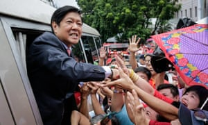 Ferdinand 'Bongbong' Marcos greets supporters outside the supreme court in Manila, Philippines on 11 July.