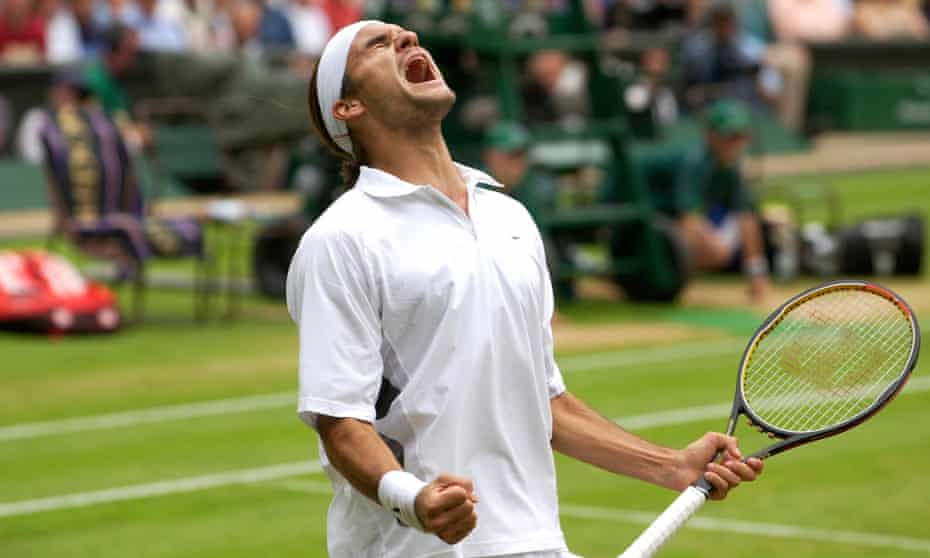 Roger Federer celebrates beating Andy Roddick in the 2003 Wimbledon semi-final.