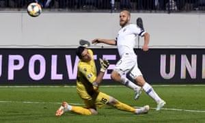 Finland's Teemu Pukki scores past Armenia goalkeeper Aram Ayrapetyan.