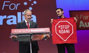 Bill Shorten with a Stop Adani protester.
