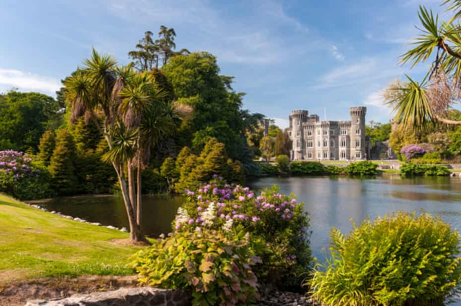 View across a lake to Johnstown Castle, County Wexford, Ireland.