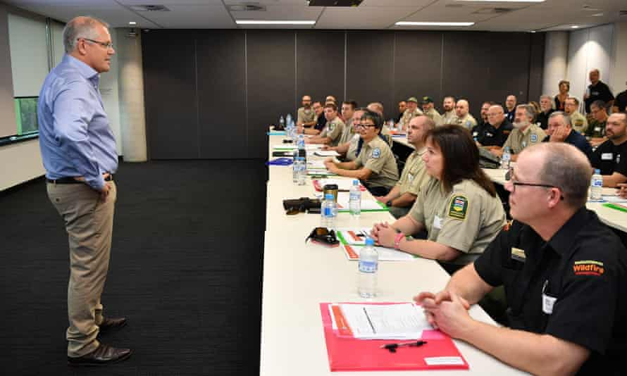 Scott Morrison greets firefighters from Canada at the NSW Rural Fire Service control room in Sydney on Sunday.