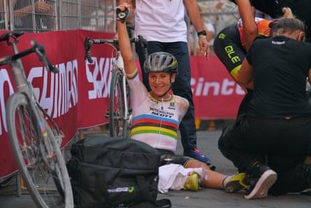 An exhausted Annemiek Van Vleuten of the Netherlands celebrates after winning the women's race.