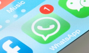 WhatsApp icon on mobile screen