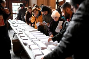 Voters pick up their ballot papers at a polling station at the University of Barcelona