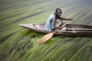 Matthias, delegate of the Mobaye refugees, leaves for work along the Oubangui River, at Longo island.