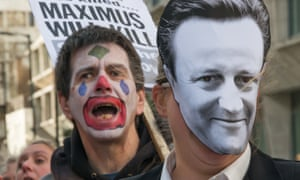 Activists dress as clowns to protest against US firm Maximus.