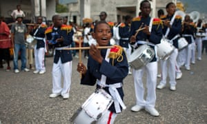 A marching band performs in Port-au-Prince.