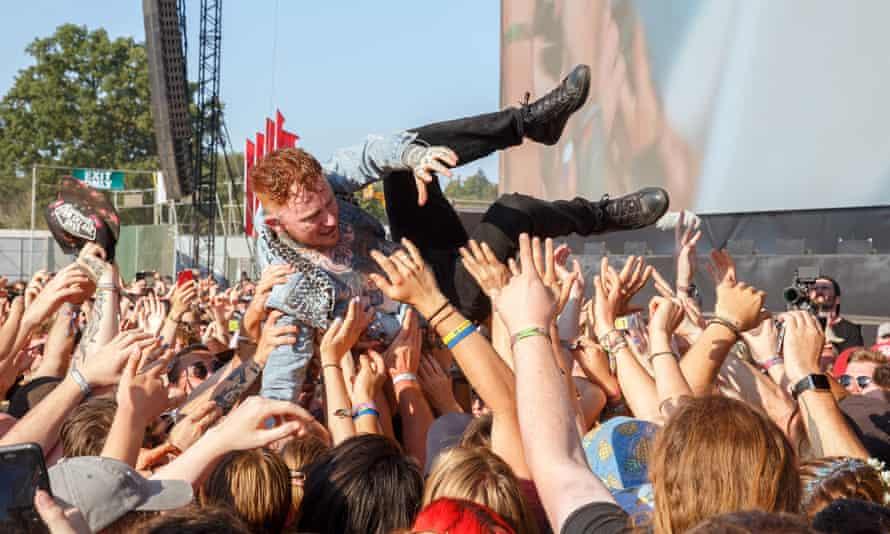 Frank Carter crowdsurfs at Reading festival, 25 August 2019.