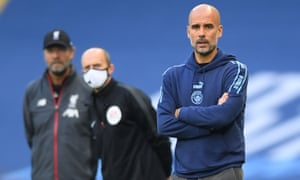 Pep Guardiola watching Manchester City play Liverpool