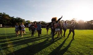 Choir girls running on a green field