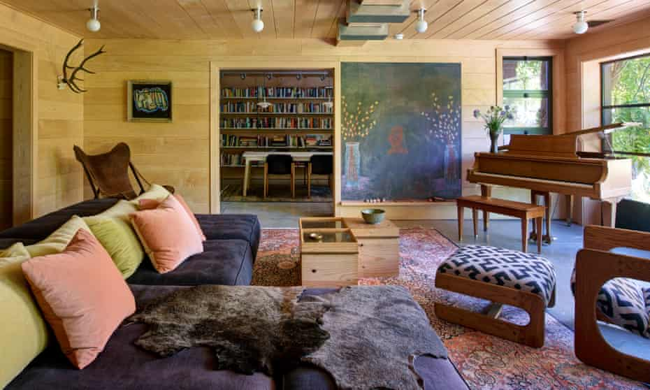 With the grain: the living room, with custom-made sofas and cupboards, and rug by Amadi Carpets.