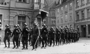 German soldiers marching through a town in Holland in May 1940.