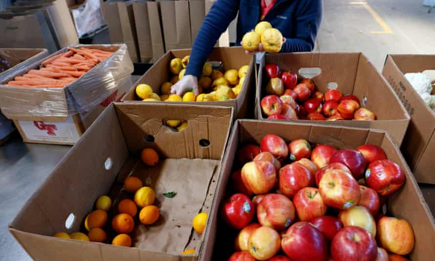 A volunteer sorts through fruits and produce at the Alameda Food Bank in California.
