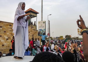 SUDAN-UNREST-DEMOAlla Salah stands on a vehicle as she sings to the crowd.