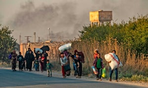 Civilians flee with their belongings.