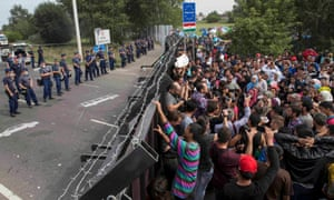 A barrier blocks a route for migrants