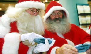 Santas get their hands on Nintendo's Game Boy Advance in 2001.