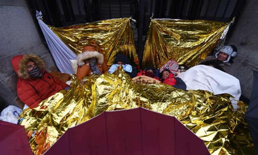 Venezuelan immigrants (l-r) Daniel, Yevely, Miguel Salazar, Vitoria, Iesta, Primari and Caren Ramirez shelter together in central Madrid