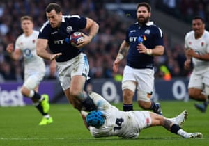 England's wing Jack Nowell tackles Scotland's wing Tim Visser.