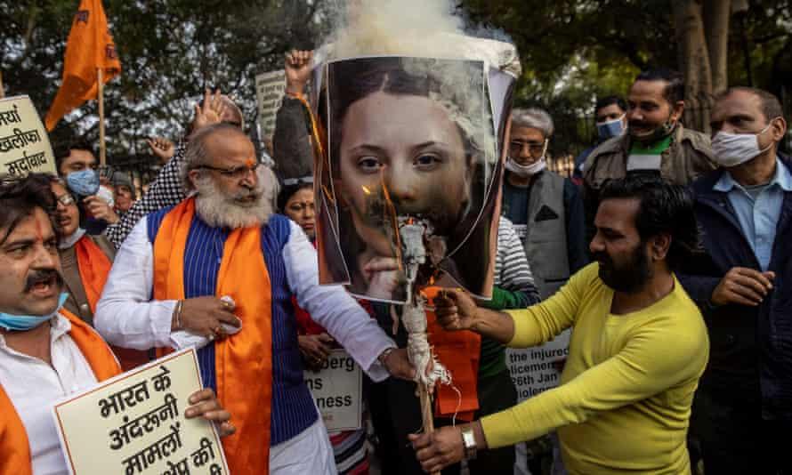 Activists burn an effigy depicting Greta Thunberg in Delhi