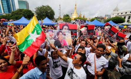 People gather to listen to Aung San Suu Kyi's speech in Yangon