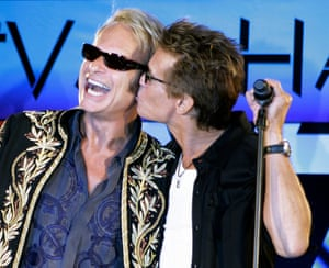 David Lee Roth gets a kiss and his former bandmates in Van Halen, Eddie Van Halen, after they announced the band's new North American tour during a news conference at the Four Seasons Hotel in Los Angeles Monday, August 13, 2007.