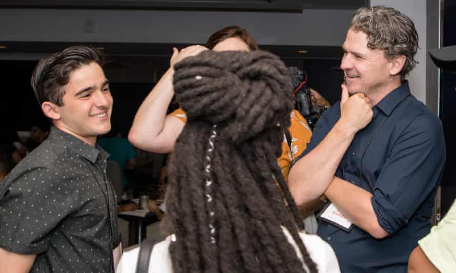 Dave Eggers talks with youth delegates, including Salvador Gómez-Colón, left, at the International Congress of Youth Voices in San Juan, Puerto Rico.