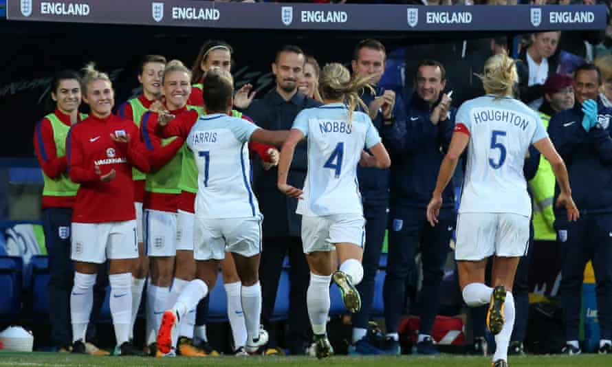 England players rush to celebrate their first goal with their manager, Marks Sampson during the 6-0 win over Russia at Prenton Park on Tuesday night.