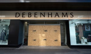 Boarded-up entrance of Debenhams store in central London